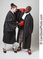 Lawyer fight - woman and man in canadian lawyer toga having...