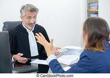 Lawyer in heated discussion with client