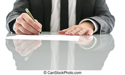 Lawyer signing document - Cropped view of lawyer sitting at...