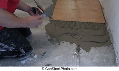 lay ceramic floor tile