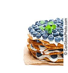 Layered pancakes with mascarpone cream and blueberry