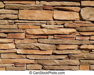 Layered Stone Wall - Flat, tan stones layered into a wall