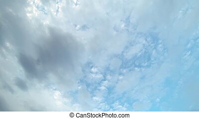 Layers of Puffy Clouds Driting against a Blue Sky - Multiple...