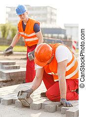 Laying a pavement