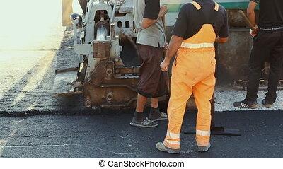 Laying asphalt pavement using speci - Volgograd, Russian...