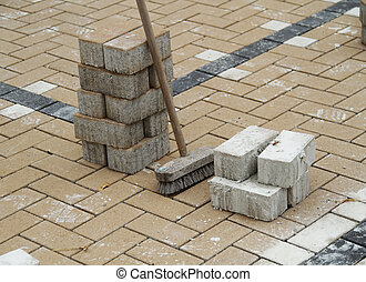 laying brick flooring - the process of laying brick down in...