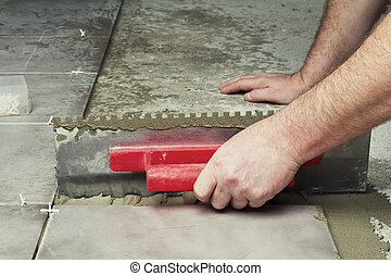 Laying ceramic tiles. - Renovation - Man construction worker...