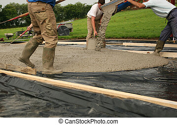 Laying Concrete - Wet concrete being poured from a chute ...