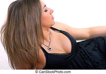 laying girl in black dress