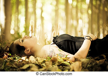 Laying girl on the forest