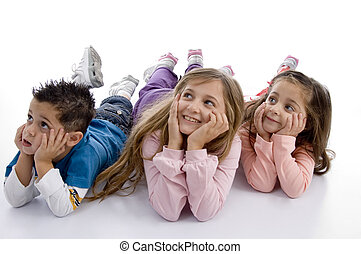 laying kids looking upward on an isolated background