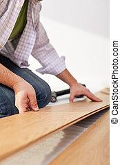 Laying laminate flooring - closeup