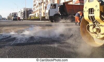 Laying of asphalt.