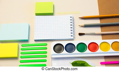 Laying out stationery on the background with paper