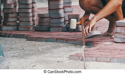 Laying Paving Stones. Worker is Laying Paving Stones using...