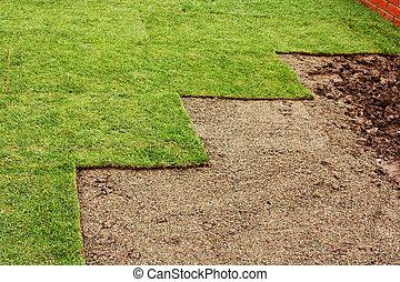 laying turf - freshly layed turf at housing estate garden