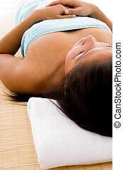 laying woman in towel