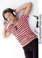 laying woman listening music