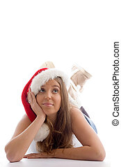 laying young woman with christmas hat