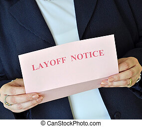 Layoff Notice - Female executive reading a layoff notice...