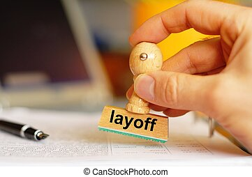 layoff stamp in business office showing unemployment concept