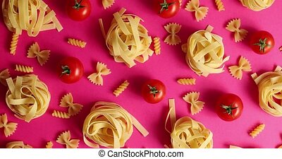 Layout of pasta and red tomatoes - Flat lay of abstract...