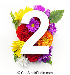 Layout with colorful flowers, leaves and number two. Flat lay. Top view.