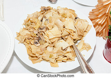 Lazanki - Pasta mixed with cabbage or sauerkraut and small ...