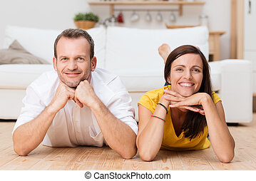 Lazy attractive young couple unwinding at home