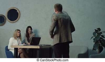 Lazy female workers using phone in office avoiding work -...