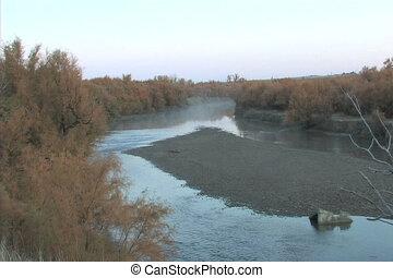 Lazy River Sunrise - the arkansas river flows slowly in...