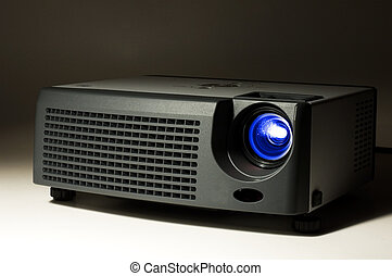 LCD projector in darkness with light on