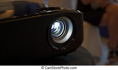 LCD video projector at business conference or lecture in office