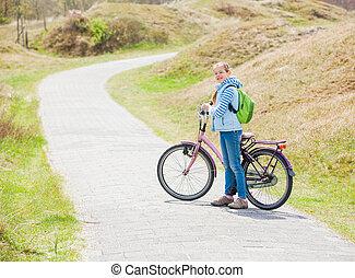leány, bicikli