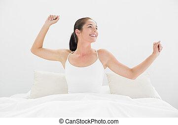 le womanen, vapen, säng, sträckande