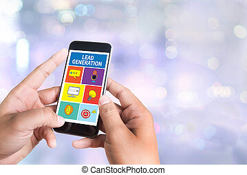 LEAD GENERATION person holding a smartphone on blurred...