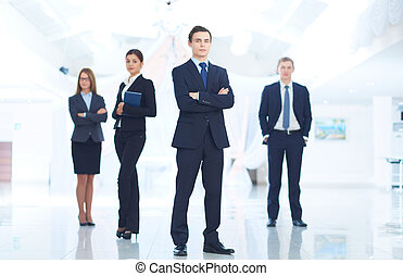 Leader and team - Portrait of young businessman looking at...