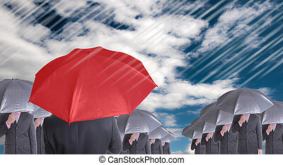 Leader holding red umbrella for show different think with ...