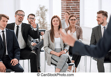 leader of the business people giving a speech in a...