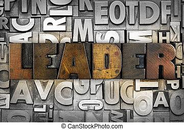 The word LEADER written in vintage letterpress type