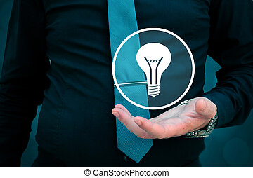Leader think about business, creativity, business vision. Businessman holding light bulb in his hand