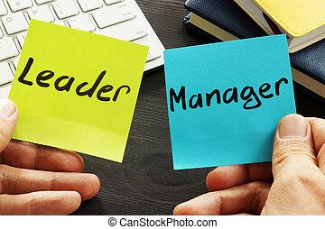 Leader vs manager. Man is holding memo sticks.