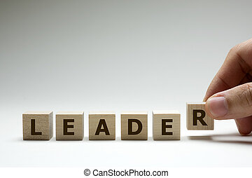 Leader word made from wooden cubes with letters alphabet