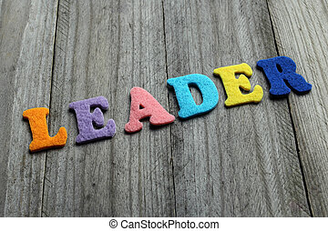 leader word on wooden background
