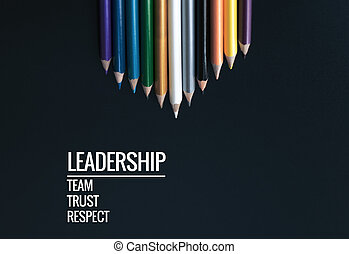 Leadership business concept. white color pencil lead other color with word Leadership, team, trust and respect on black background