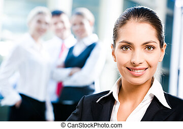 Leadership - Face of female leader on the background of her...
