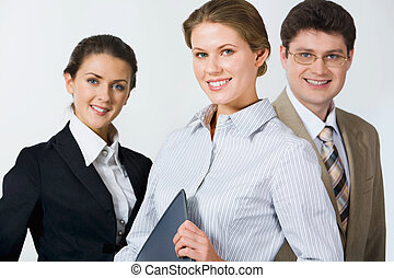 Leadership - Customary business group of smiling...