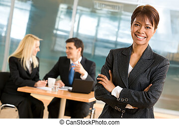 Leadership - Portrait of beautiful businesswoman standing at...