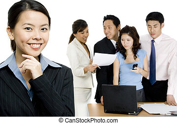 Leadership - An attractive businesswoman standing in front...