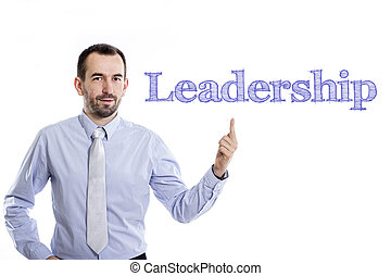 Leadership - Young businessman with small beard pointing up in blue shirt